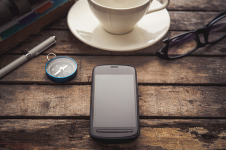 smart phone with  glasses, coffee, note on the wood desk. Stock Photo