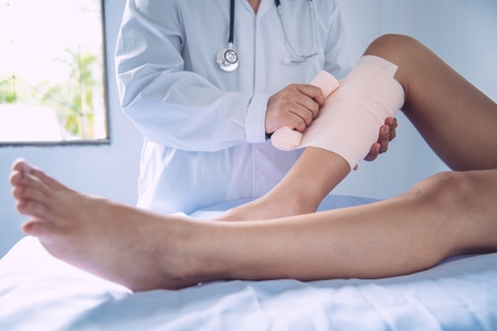 Doctors are treating patients with leg injuries Stock Photo