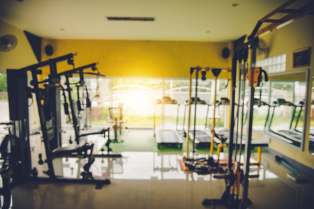 Blur the gym with exercise equipment and light in the morning. Stock Photo