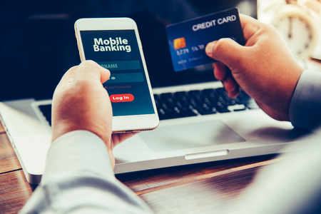 hands using mobile banking on smart phone
