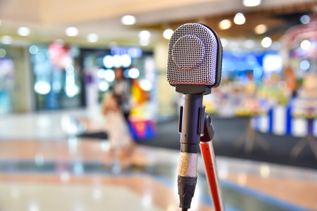 Microphone on abstract blurred of The space in the meeting and stage performances