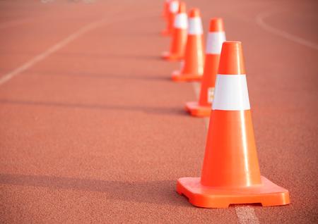Road cone on orange floor To block the way and indicate Banco de Imagens