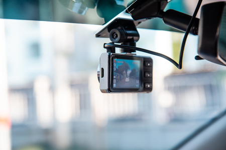 Car video camera attached to the windshield to record driving and prevent danger from driving Banco de Imagens