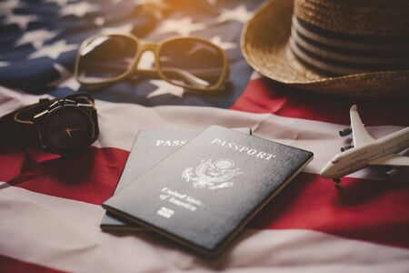 Passport is placed on the US flag. Preparing for a legitimate journey