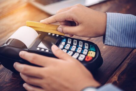 Paying by credit card , buying and selling products using a credit card swipe machine