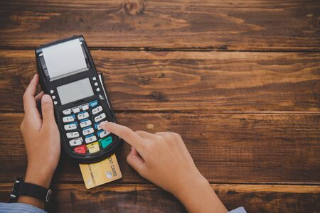 Top view Paying by credit card , buying and selling products using a credit card swipe machine Reklamní fotografie