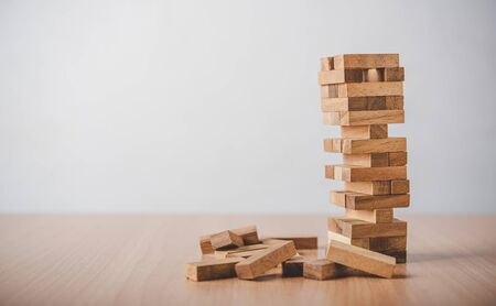 game drew to a wooden block from the tower.concept  business risks in the business. Requires planning meditation must be careful in deciding to reduce the risk in the business.