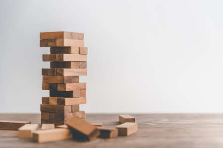 game drew to a wooden block from the tower.concept business risks in the business. Requires planning meditation must be careful in deciding to reduce the risk in the business. 版權商用圖片