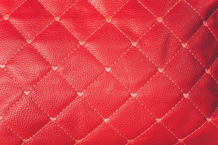 close-up red leather sofa backrest background