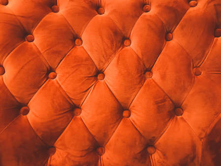 close-up orange leather sofa backrest background