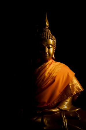golden buddha in dark Stock Photo