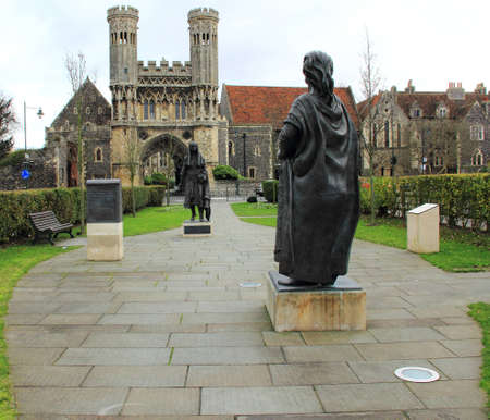 royality: Medieval Gate of St Augustines Abbey in the Background of the Statues of the King and Queen of Kent