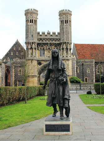 royality: Medieval Gate of St Augustines Abbey in the Background of the Statue of the Queen of Kent