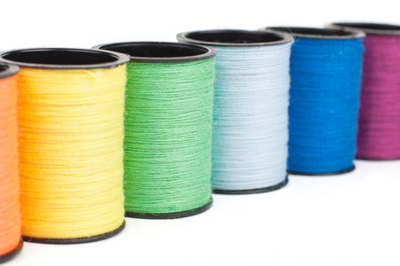 needlecraft product: Thread bobbins in a row close-up