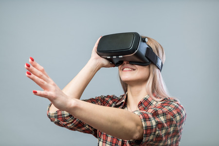 futuristic girl: Young cheerful woman with vr headset