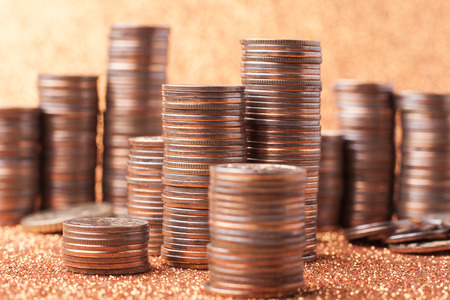 silver coins: Stack of coins on golden sparkle background. Financial concept Stock Photo
