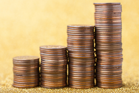silver coins: Stacks of coins on golden sparkle background. Financial concept Stock Photo