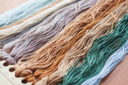 Close up set of colorful wool threads. Abstract hobby background Standard-Bild