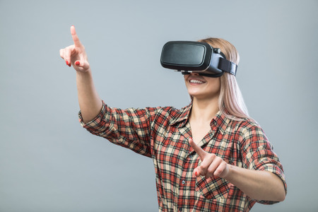 Young cheerful woman with vr headset
