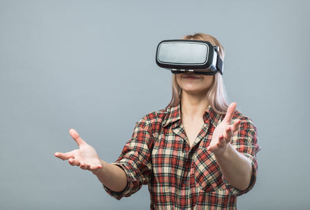 virtual reality simulator: Young cheerful woman with vr headset