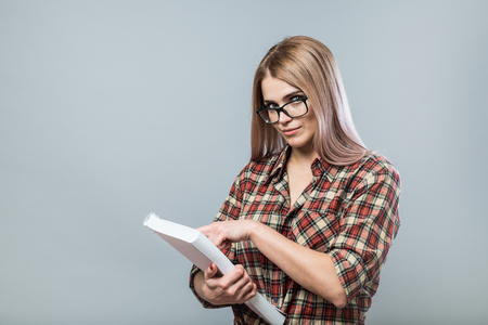 Young attractive woman in glasses hold book Stock Photo