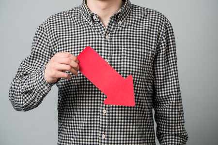 Some man in shirt pointing red arrow down. Business concept for crisis situation Stock Photo
