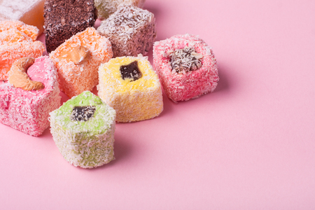 pistachio: Eastern various colorful sweets on pink background Stock Photo