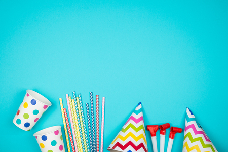 Set of birthday party items on light blue surface view from above