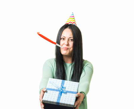 Young cute brunette girl celebrating birthday with party stuff giving gift