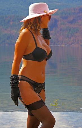 garter belt: A sexy woman fashion model wearing lingerie outdoors