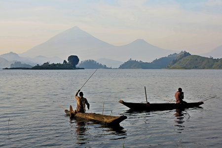 Men fishing in river on log boat