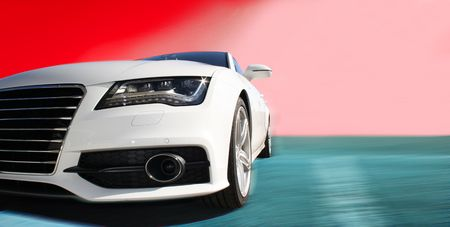 white sports car on a colorful background