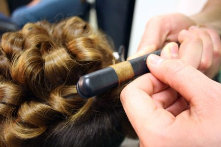 Master hairdresser cuts a customer's hair Stock Photo - 8100953