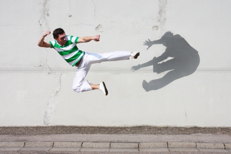 aikido: man fighting against his own shadow Stock Photo