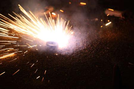 burning firecracker on New Years Eve  photo