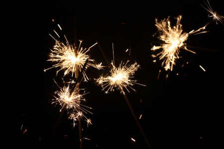 burning sparkler on New Year�s Eve photo