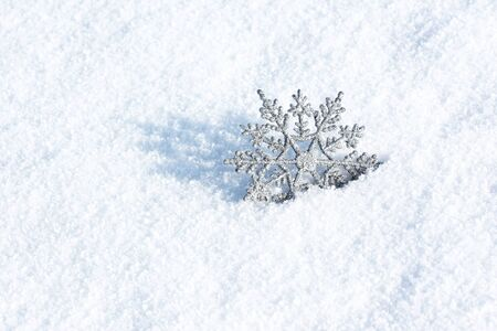 beautiful silver snowflake in snow Stock Photo