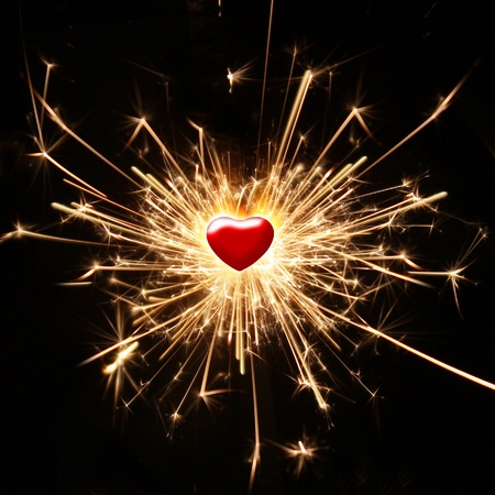 burning sparkler in the shape of a heart photo
