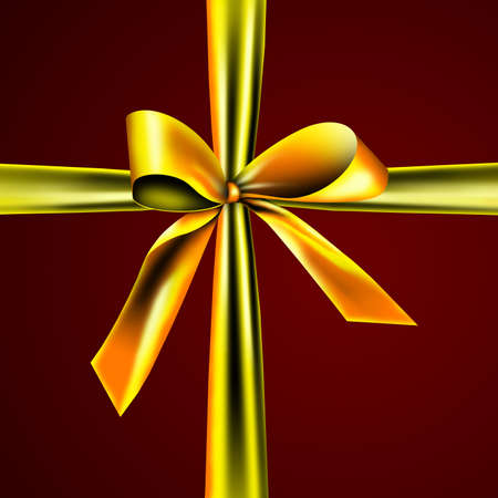 A golden ribbon with a knot isolated on red photo