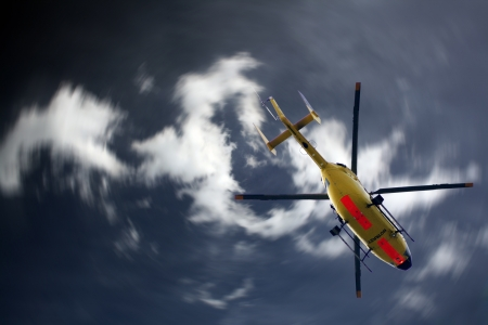 helicopter pilot: Helicopter on the way to use Stock Photo