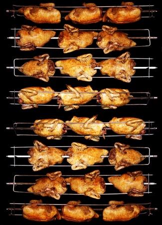 Lekkere gegrilde kip goudbruin aan het spit