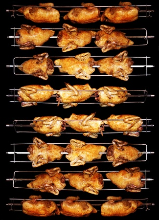 chiken: Tasty grilled chicken turn golden brown on the spit