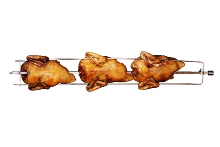 chiken: Delicious rotisserie chicken turning on a spit