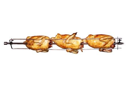 pollo rostizado: Delicioso pollo asado girando en un asador