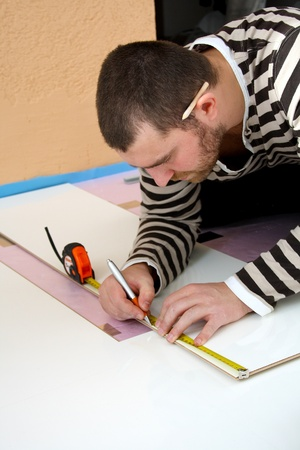 Workers laid laminate in home renovation Stock Photo - 10929780