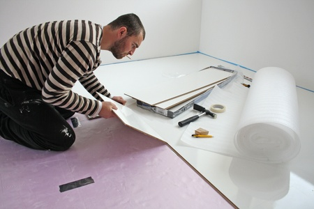 Workers laid laminate in home renovation Stock Photo - 10929843