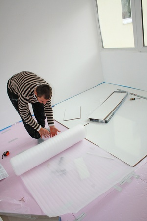 Workers laid laminate in home renovation photo