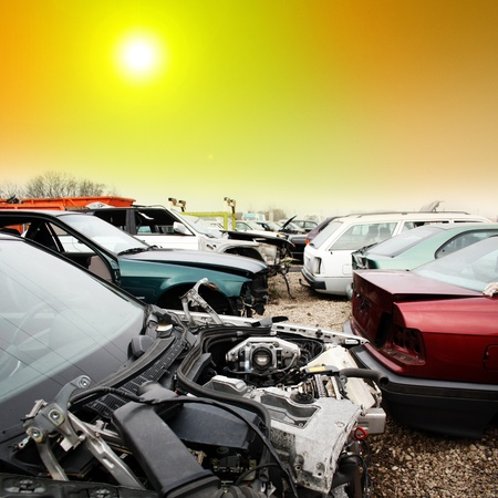 discarded metal: scrap yard for car recycling Stock Photo