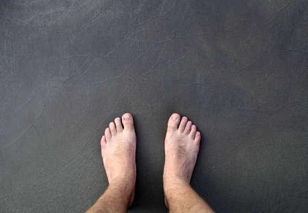 barefoot man on sea beach photo