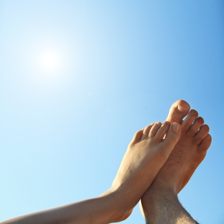 feet relaxing: male and female foot high direction sky